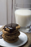 Milk & Cookies with chips & ganache on a white plate Stock Image