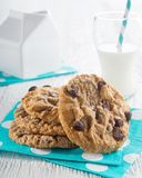 Milk and cookies. Delicious homemade chocolate chip cookies and a glass of milk on a white background Stock Photography