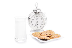 Milk and cookies this morning. Milk and cookies with a clock isolated on white background Royalty Free Stock Images