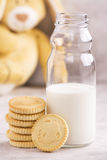 Milk and cookies over stone background Stock Photos
