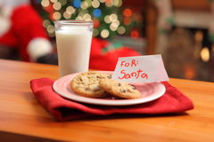 Milk and cookies for Santa stock images