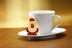 Milk and cookies for santa. On table with gold background Royalty Free Stock Images