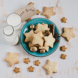 Milk and cookies for Santa Claus. Milk in a bottle and glass and cookies for Santa Claus Royalty Free Stock Photography