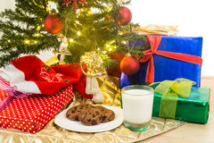 Milk and cookies for Santa Clause under Christmas tree. Royalty Free Stock Photography