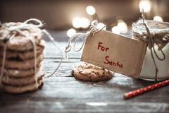 Milk and cookies for Santa. A stack of cookies and glass of milk for Santa on wooden background, concept Christmas and holiday Stock Images