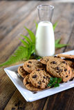 Milk and cookies. Some cookies and milk for a tasty snack Royalty Free Stock Images