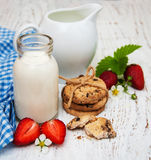Milk, cookies and strawberries Stock Images