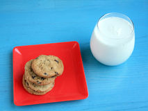 Milk and cookies top view green wooden Royalty Free Stock Image