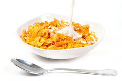 Milk with corn flakes for breakfast stock image