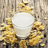 Milk and cornflake on table wooden background Royalty Free Stock Photo