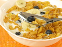 Milk with cornflakes and fruits Stock Photos