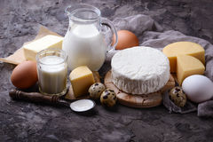 Milk, cottage cheese, sour cream, butter, eggs. Dairy products. Milk, cottage cheese, sour cream, butter and  eggs. Selective focus Stock Photography