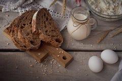 Milk, cottage cheese, sour cream, multigrain homemade bread, fre Stock Photography