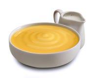 Milk cream. White china pot with milk dessert cream Stock Photography