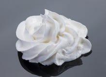 Milk cream froth. White milk cream froth closeup on dark royalty free stock images