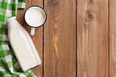 Milk cup and bottle Stock Photos
