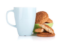 Milk cup and bowl with cookies Stock Image