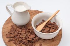 Milk in the cup and chocolate cornflakes Stock Photo