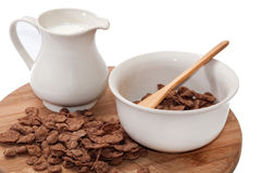 Milk in the cup and chocolate cornflakes Stock Images