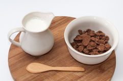 Milk in the cup and chocolate cornflakes Stock Photography