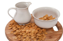 Milk in the cup and cornflakes in the bowl Stock Image