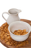 Milk in the cup and cornflakes in the bowl Royalty Free Stock Images