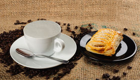 Milk cup with croissant Stock Image