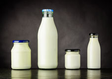 Milk and Dairy Products in Bottle and Jar. Different Types of Milka and Dairy Products in Bottle and Jar on Dark Background Stock Photos