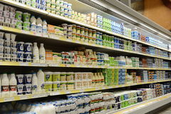 Milk and dairy products on shelves Stock Images