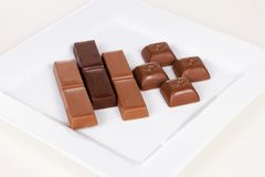 Milk and dark chocolate Stock Images