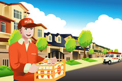 Milk delivery man delivering to a house Royalty Free Stock Image