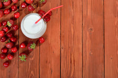 Milk deser with berries on wooden background. Royalty Free Stock Photography