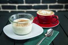 Milk desert served with coffee. On the table stock photo