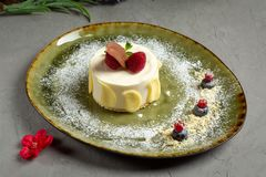 Milk dessert with fruit and chocolate on a gray background stock photos