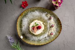 Milk dessert with fruit and chocolate on a gray background royalty free stock photography