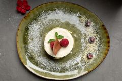 Milk dessert with fruit and chocolate on a gray background royalty free stock photo