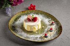 Milk dessert with fruit and chocolate on a gray background royalty free stock images