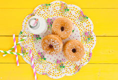 Milk and donuts Stock Photography
