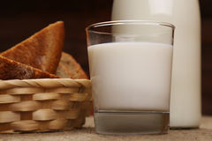 Milk in a drink glass with rye bread Royalty Free Stock Photo
