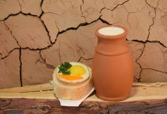 Milk and eggs with bread. Rustically Royalty Free Stock Images