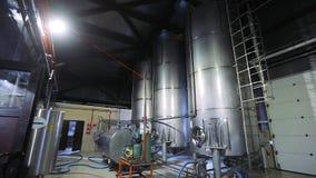 Milk factory equipment. Large steel milk storage tanks.