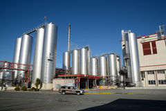 Milk factory. HOKITIKA, NEW ZEALAND, 27 JUNE, 2016: Storage silos at the Westland Milk Products factory  in Hokitika, New Zealand ready for deliveries of fresh Royalty Free Stock Image