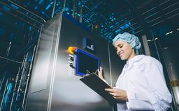 Milk factory production. Industrial worker machinery technology Stock Image