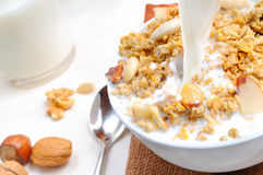 Milk falling on a bowl full of cereal Royalty Free Stock Photography