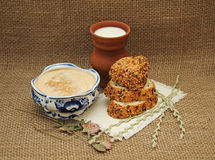 Milk fermented baked milk in pottery and bread with sesame seeds Royalty Free Stock Photo