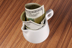Milk filled with cash Royalty Free Stock Image