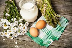 Milk and flowers on a wooden background Stock Photo