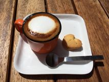 Milk foam Espresso. Coffee cup with cookie and Stock Photo
