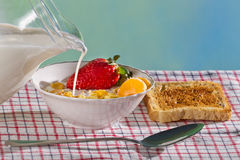 Milk and fresh fruit with corn flakes Stock Images