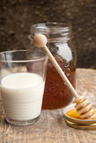 Milk and the fresh honey Stock Images
